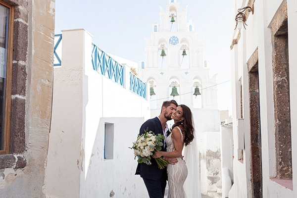 Romantic wedding in Santorini with white flowers and greenery   Alexis & Lee
