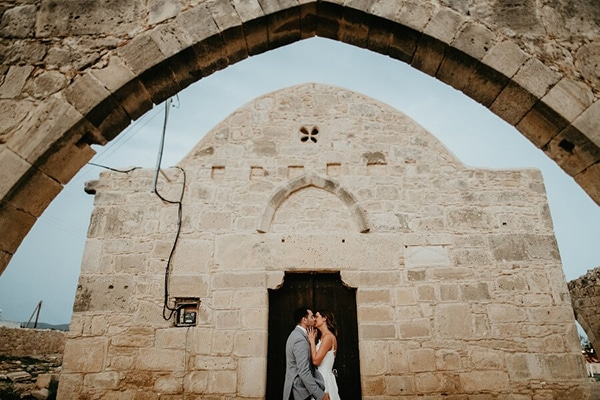 Rustic summer wedding with greenery and white flowers in Paphos | Eleni & Dean